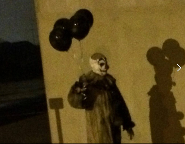 Creepy clown with balloons